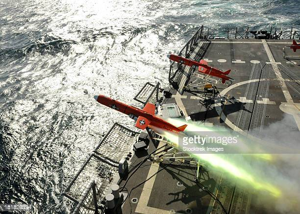 A BQM-74E aerial drone launches from the guided-missile frigate USS Thach.