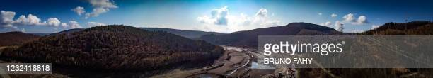 Aerial drone llustration shows the Coo artificial lake, empty of its water, Tuesday 20 April 2021, in Stavelot. The lake is being emptied to carry...
