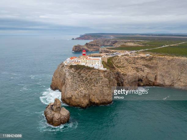 aerial drone panoramic view of the lighthouse and cliffs at cape st. vincent at sunset. algarve seascape.  amazing landscape.continental europe's most south-western point, sagres, portugal. - sagres bildbanksfoton och bilder