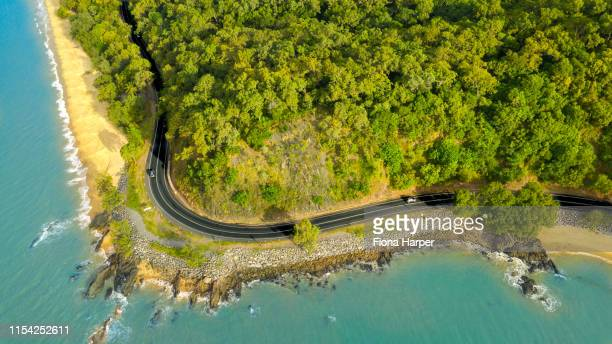aerial drone photo of coastal and nature scene and coastal highway - cairns stock pictures, royalty-free photos & images