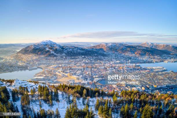 aerial drone shot of the view of bergen city from mount fløyen, norway wintertime - bergen norway stock pictures, royalty-free photos & images