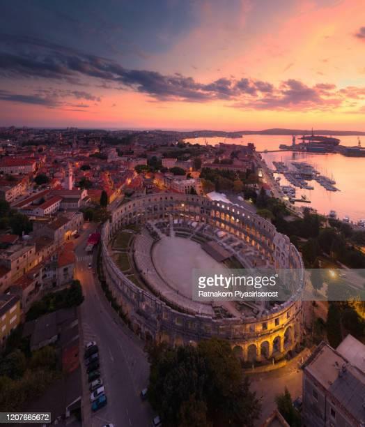 aerial drone sunset scene of pula arena amphitheatre, croatia - イストリア半島 プーラ ストックフォトと画像