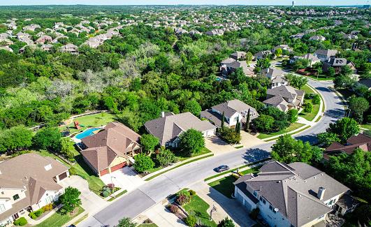 Aerial drone view above suburb homes in Cedar Park , Texas 1132833149