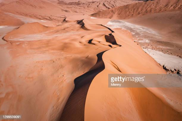 aerial drone view along sossusvlei sand dune namibian desert namibia - mlenny stock pictures, royalty-free photos & images