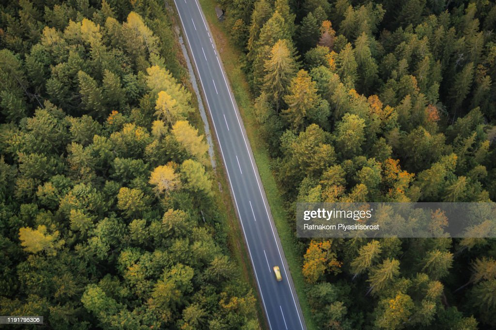 Aerial Drone View Of A Car Runs Along A Road Flanked By A Green And Yellow Forest In Autumn Of Upper Austria State Near By Hallstatt Austria High Res Stock Photo Getty