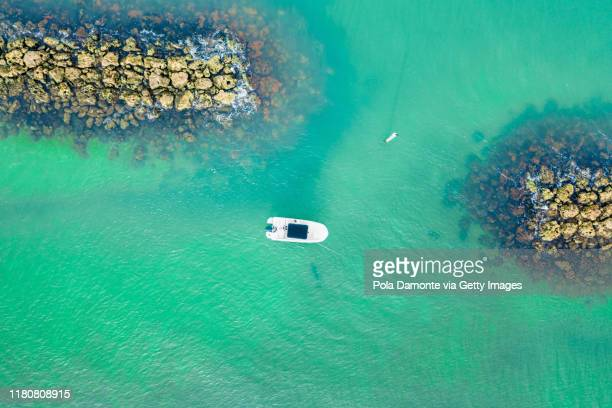 aerial drone view of a ship in the sea in marco island, florida at sunrise - marco island stock pictures, royalty-free photos & images