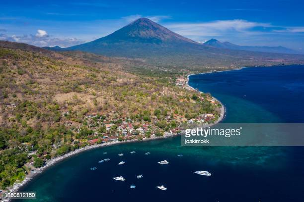 aerial drone view of amed village in bali indonesia - coral sea stock pictures, royalty-free photos & images