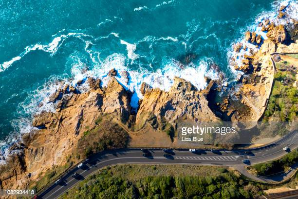 aerial drone view of coastal road in tuscany, italy - italia foto e immagini stock