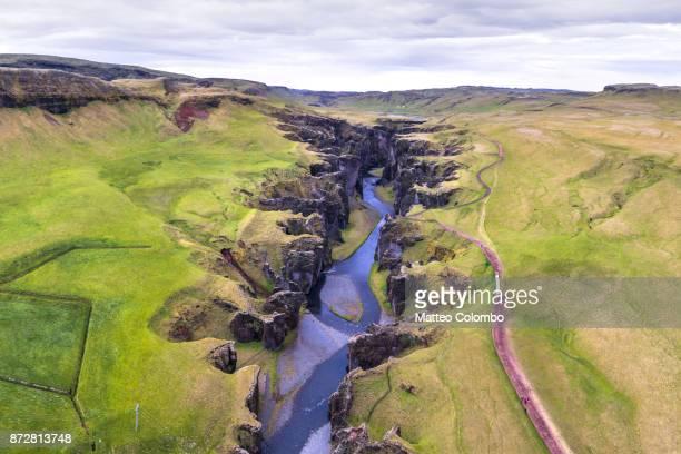 aerial drone view of fjadrargljufur canyon, iceland - geologia foto e immagini stock