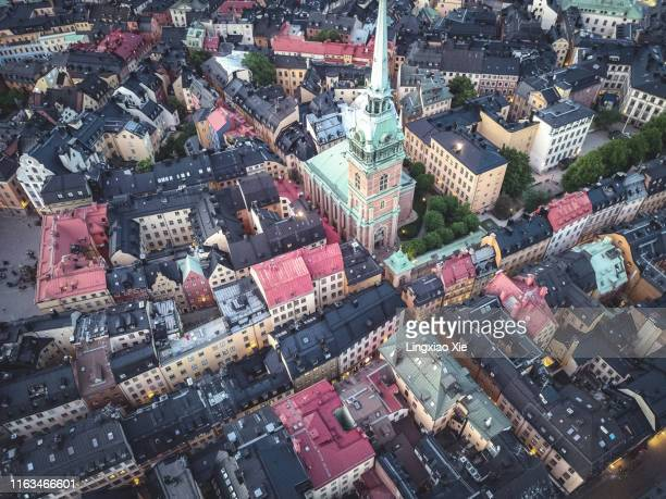 aerial drone view of riddarholm church and riddarholmen city skyline, stockholm, sweden. taken by drone from above. - stockholm stock pictures, royalty-free photos & images