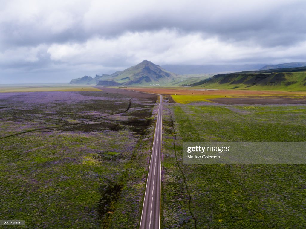 aerial drone view of ring road through plains iceland ストックフォト