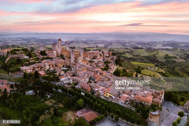 Aerial drone view of San Gimignano town at dawn, Tuscany, Italy