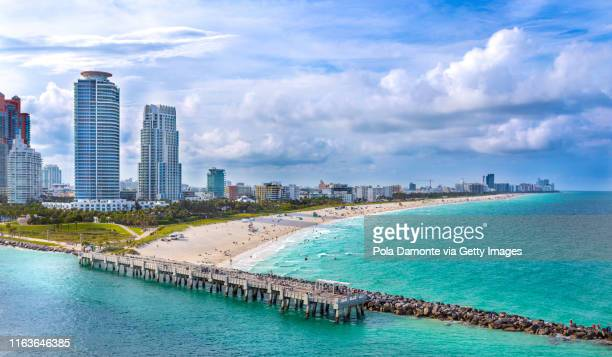 aerial drone view of south beach in miami from south pointe park, florida, usa - miami beach stock pictures, royalty-free photos & images