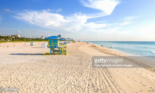 aerial drone view of south beach with lifeguard towers and waves on the beach, miami, florida at sunrise - south beach stock pictures, royalty-free photos & images