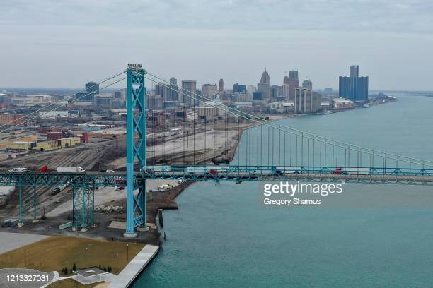 Aerial drone view of the Ambassador Bridge that connects Detroit and Windsor Canada on March 18 2020 in Detroit Michigan The US and Canada have...