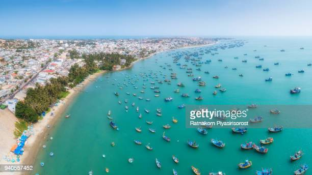 aerial drone view of thousand of boat and ship in mui ne village, phan thiet, vietnam - southeast stock pictures, royalty-free photos & images