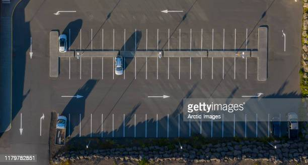 aerial -few cars parking in a parking lot. - small group of objects stock pictures, royalty-free photos & images