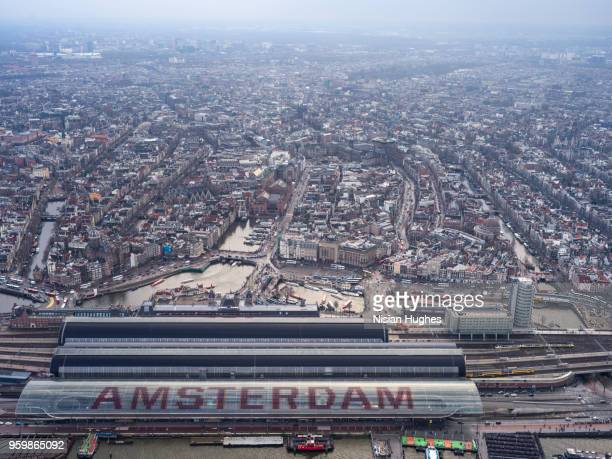aerial flying over amsterdam train station - amsterdam stock pictures, royalty-free photos & images