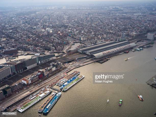 aerial flying over amsterdam train station - huvudstäder bildbanksfoton och bilder