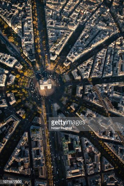 aerial flying over arc de triomphe in paris france at sunrise - パリ凱旋門 ストックフォトと画像