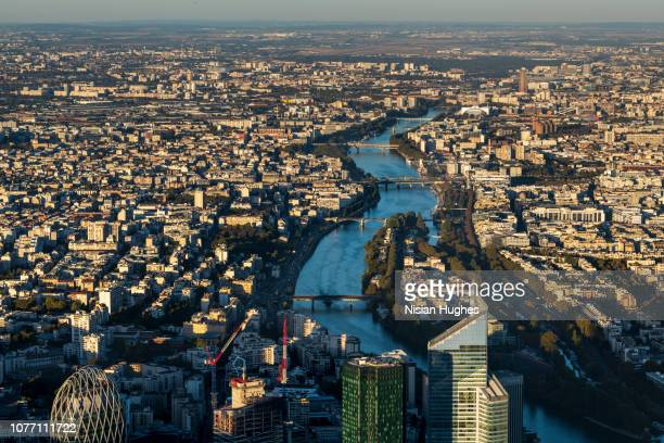 aerial flying over buildings of la défense paris france looking north - ile de france stock pictures, royalty-free photos & images