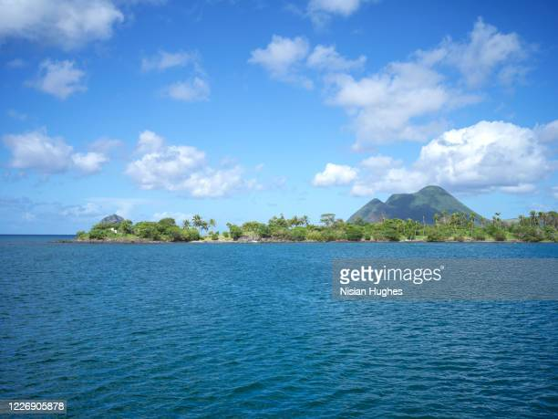 aerial flying over coast of martinique looking out over the ocean, daytime - antilles stock pictures, royalty-free photos & images