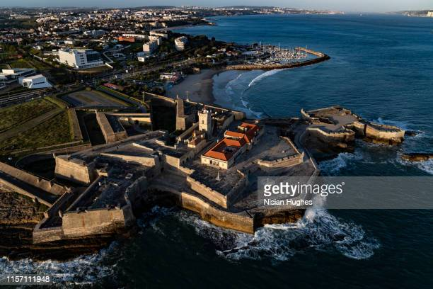 aerial flying over coastline looking at fort of são julião da barra in portugal - department of defense stock pictures, royalty-free photos & images