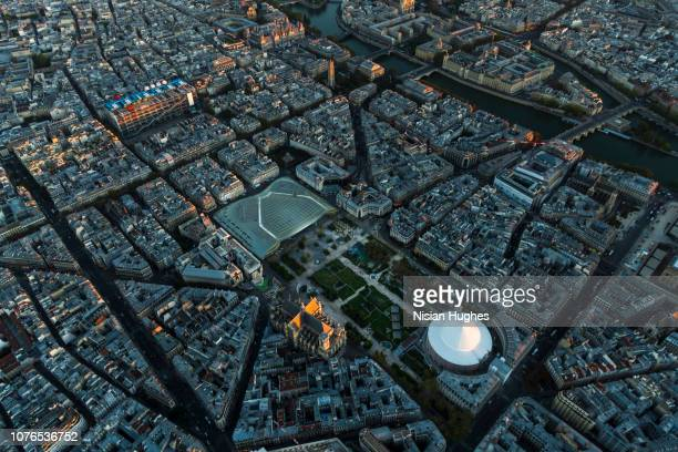 aerial flying over les halles shopping area in paris france, sunset - centre pompidou stock pictures, royalty-free photos & images