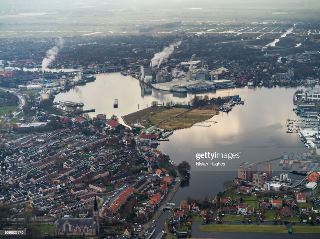 Aerial flying over outer Amsterdam, factories : Stock Photo