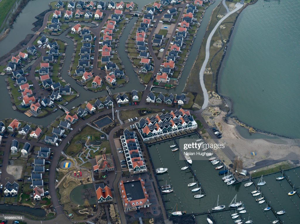 Aerial flying over outer Amsterdam, houses : Stock-Foto