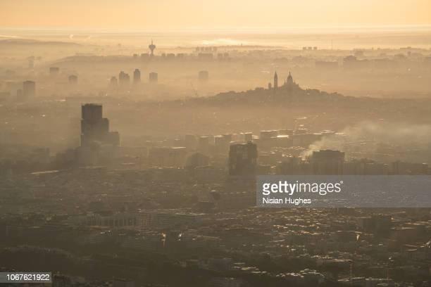 aerial flying over paris france at sunrise - bruma de calor fotografías e imágenes de stock