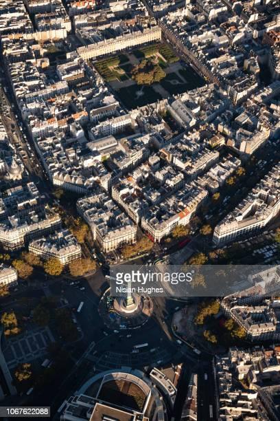 aerial flying over paris france looking at bastille, sunrise - bastille photos et images de collection