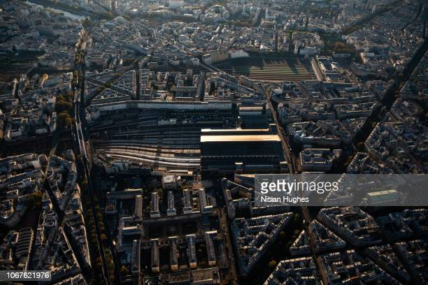 aerial flying over paris france looking at railroad stations sunrise - gare du nord stock pictures, royalty-free photos & images
