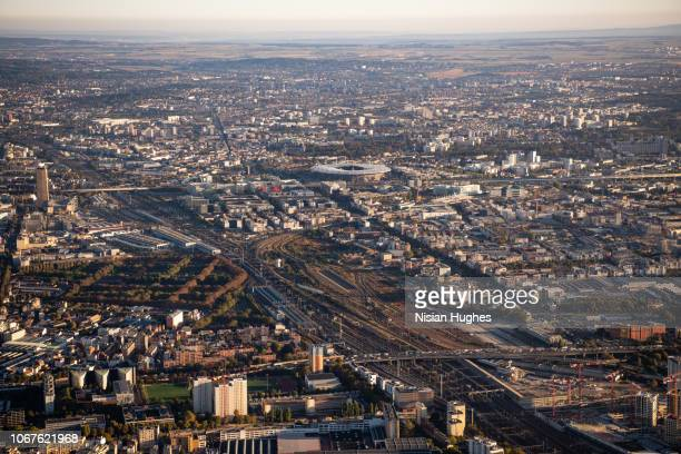 Aerial flying over Paris France with view of Stade de France at sunrise