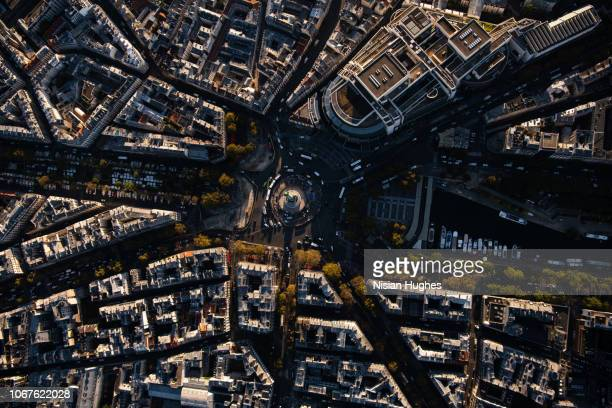 aerial flying over place de la bastille in paris france, sunrise - bastille imagens e fotografias de stock