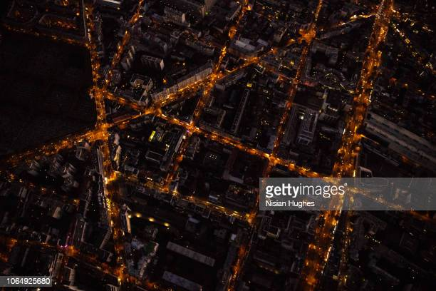 aerial flying over streets of paris france at night - night stock pictures, royalty-free photos & images