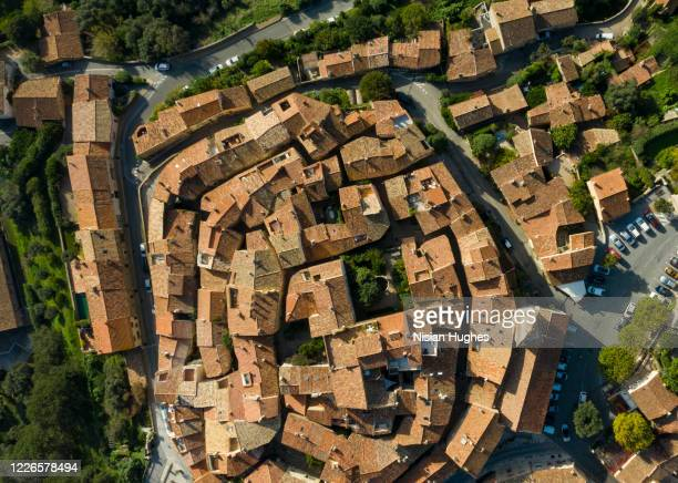 aerial flying over village of ramatuelle in france looking down on rooftops - var stock pictures, royalty-free photos & images