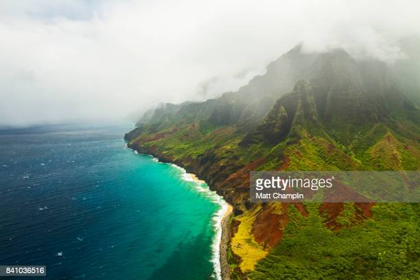 aerial from helicopter of na pali coast on kauai - kauai stock photos and pictures