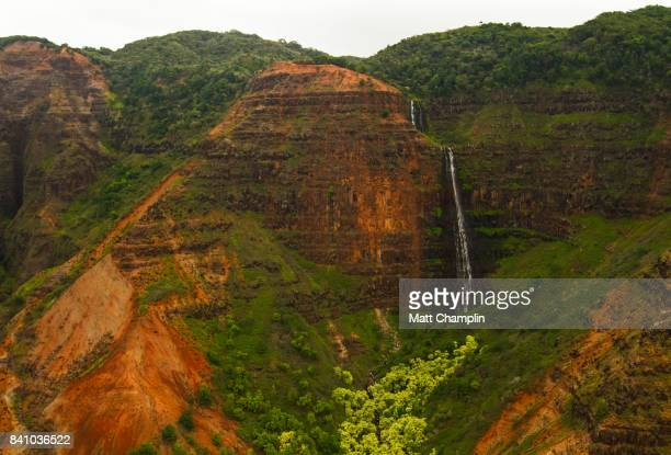 aerial from helicopter of rugged waimea canyon grand canyon of pacific - hawaiian waterfalls stock pictures, royalty-free photos & images