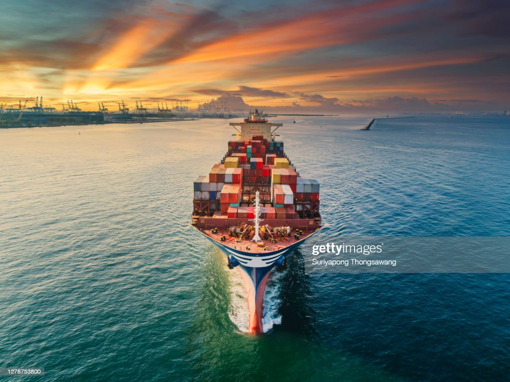 Aerial front view Container cargo ship full carrier container with terminal commercial port background for business logistics, import export, shipping or freight transportation. : Stock Photo