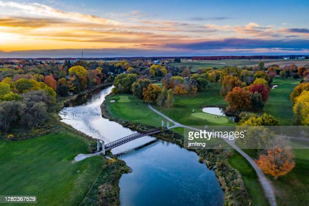 aerial grand river at dusk close to st. jacobs town in ontario, canada - ontario canada stock pictures, royalty-free photos & images