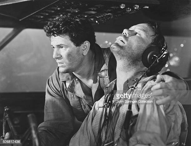 Aerial gunner Sergeant Joe Winocki tries to rouse the pilot Captain Mike 'Irish' Quincannon in Air Force