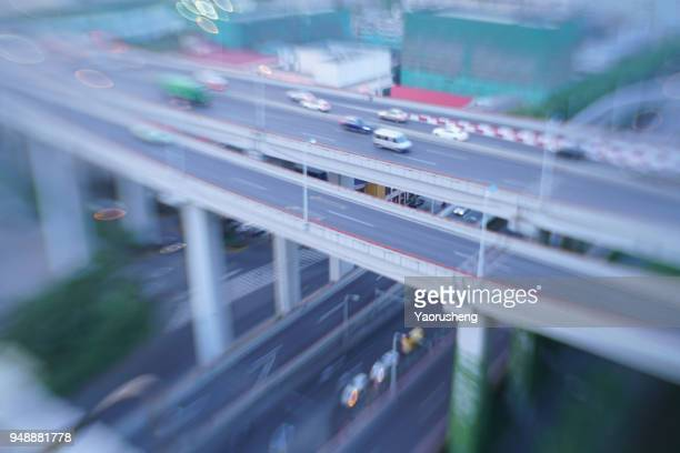 Aerial highway junction. Busy highway from aerial view..shot by tilt and shift lens