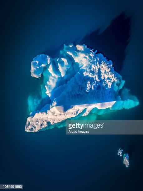 aerial - iceberg by the town of narsaq, south greenland - image stockfoto's en -beelden