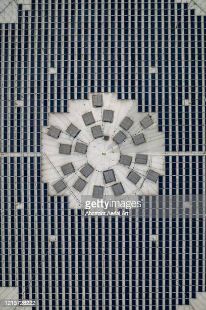 aerial image above solar panels on a roof top, spain - surrounding stock pictures, royalty-free photos & images