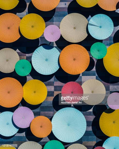 aerial image looking down on sunshades forming part of an outdoor art installation, andalusia, spain - multi coloured stock pictures, royalty-free photos & images