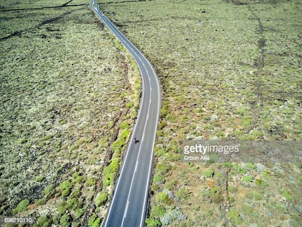 Aerial image of a cyclist in a road in Lanzarote, Spain.