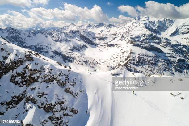 Aerial image of a group of 3 people ski touring