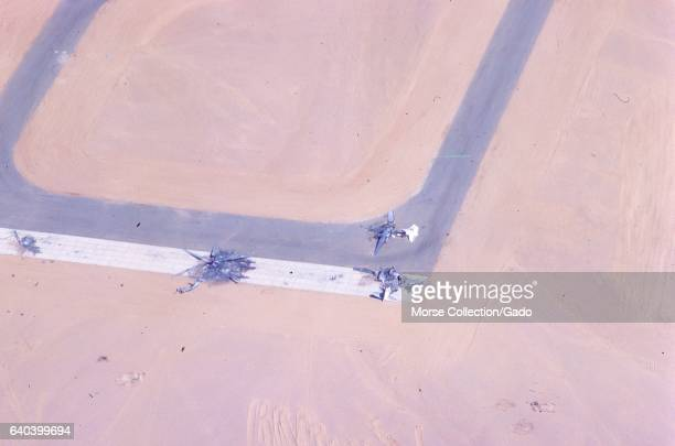 Aerial image of a portion of the Bir Gifgafa airfield runway with destroyed aircraft still on the tarmac in the Sinai desert Gaza Israel November 1967