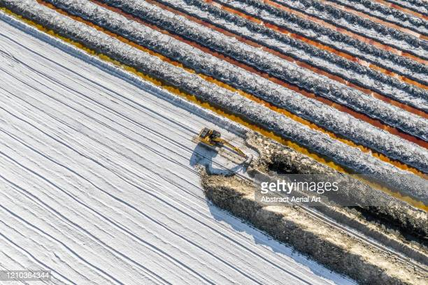 aerial image of an excavator working in a salt mine, california, united states of america - climate stock pictures, royalty-free photos & images